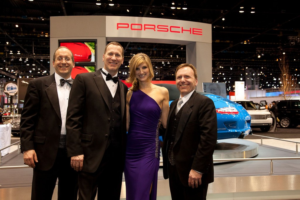 """Partygoers pose with the Porsches at the """"First Look for Charity"""" Gala"""